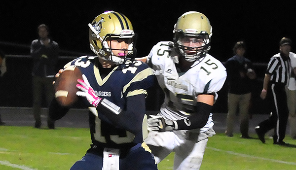 Santa Barbara's Carter Soto, who intercepted a pass and ran it back for a touchdown, pressures Dos Pueblos quarterback Barrett Burnes on a key play in overtime.