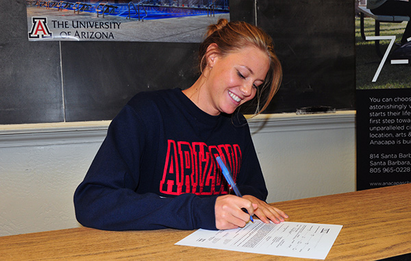 Ali Powell signs her NLI in a classroom at Anacapa School.