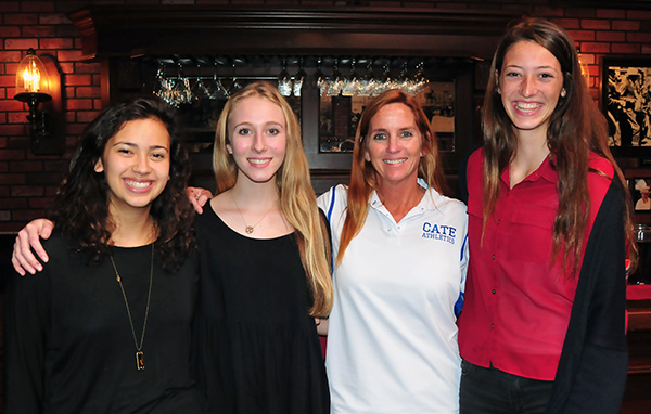 Cate volleyball players, from left, Sumner Matthews and Peyton Shelburne, with coach KC Collins, and Scholar-Athlete of the Year Lucia Johnson.