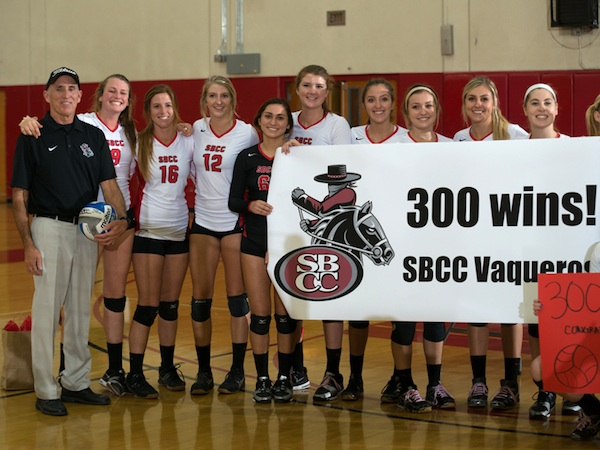 SBCC volleyball players celebrate with their coach, Ed Gover, after his 300th match victory.