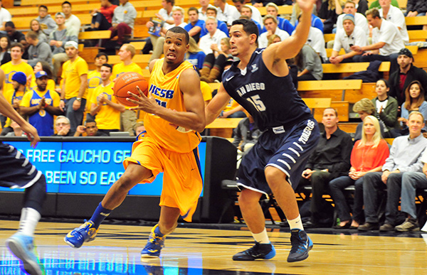 John Green, attacking the basket against San Diego's Thomas Jacobs, had a career-high eight rebounds to go with 10 points for UCSB. (Presidio Sports Photos)