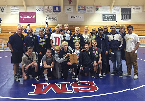 The Dos Pueblos wrestling team with its championship plaque.