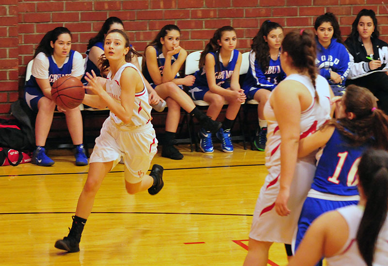 Bishop Diego's Morgan Wallace drives to the basket as teammate Hannah Rogers sets a screen.