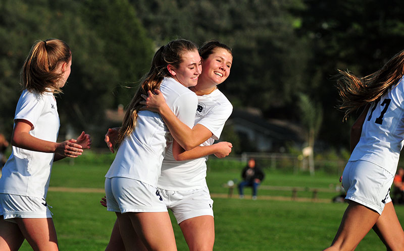 Phoebe Madsen gets a big hug after her throw-in  brushed past Hannah White and into the goal for Laguna Blanca's one goal on Thursday.