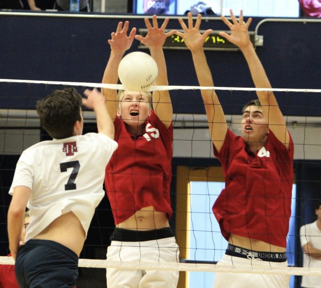 Ben Hauschild, left, and Jake Castanha combine to block a ball during the Dos Pueblos Invitational.