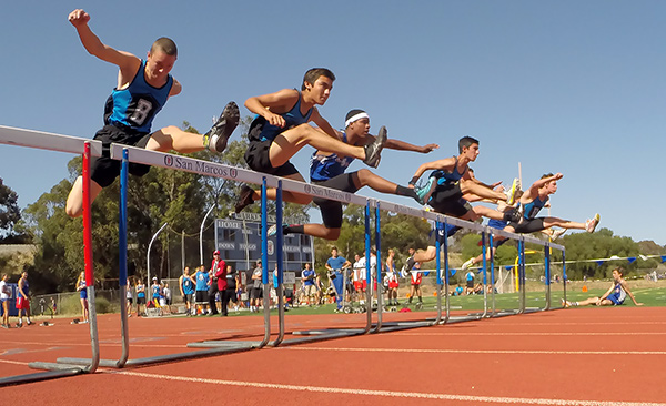 Hitting the first jump in the boys varsity 100 hurdles