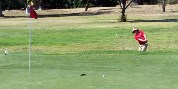 San Marcos' Sam Metzger hits from a sand trap on Monday. (Courtesy Photo)