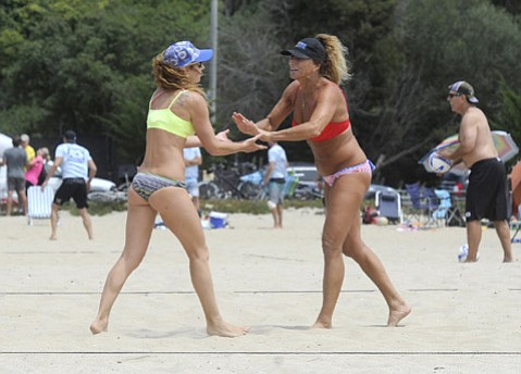 Passionate volleyballers Vladia Vignato (left) and Marla O'Hara spiked and set in the sand of East Beach. (Paul Wellman Photo)
