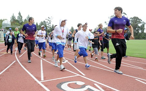 World-class athletes and coaches from Guatemala, Honduras, Nicaragua, and St. Kitts and Nevis practice for the 2015 Special Olympics World Games at Westmont College. (Paul Wellman Photo)