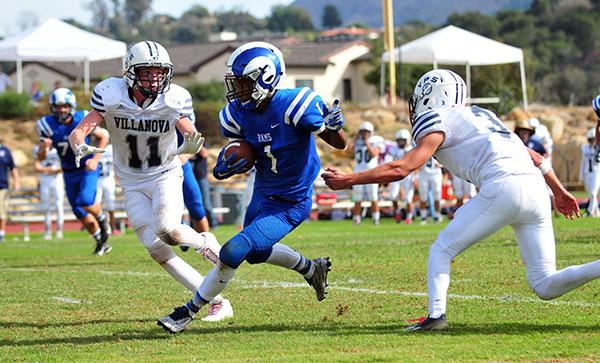 Isaiah Washington slips through the Villanova defense for a big gain. (John Dvorak/Presidio Sports Photos)
