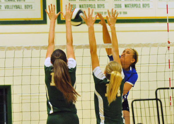 Lucy Branch, left, and Chloe Mauceri put up a block on San Marcos' Chloe Allen.