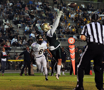 Mason Bigelow leaps to grab Santa Barbara's first touchdown in front of defender Isaac Lopez.