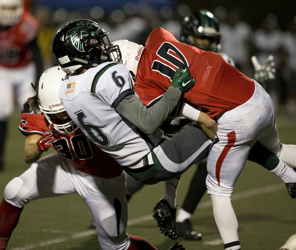 Austin Bohnett puts a jarring hit on Palmdale's Chris Simmons to force a fumble. Matt Shotwell picked up the ball and ran it 22 yards for a touchdown during the second quarter.
