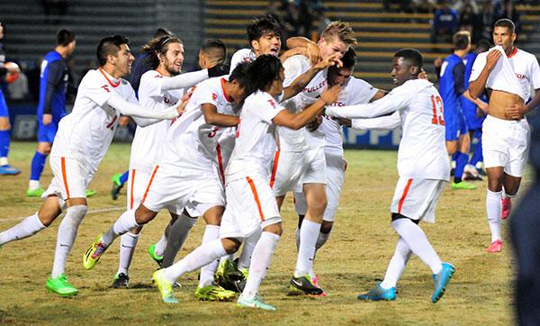 Fullerton celebrates with goal-scorer in the middle. (John Dvorak/Presidio Sports Photos)