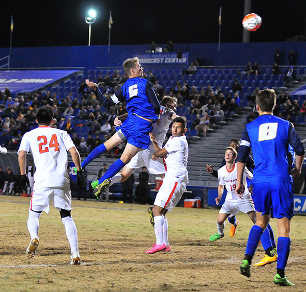 UCSB's Nick DePuy skies for a corner kick in the first half.