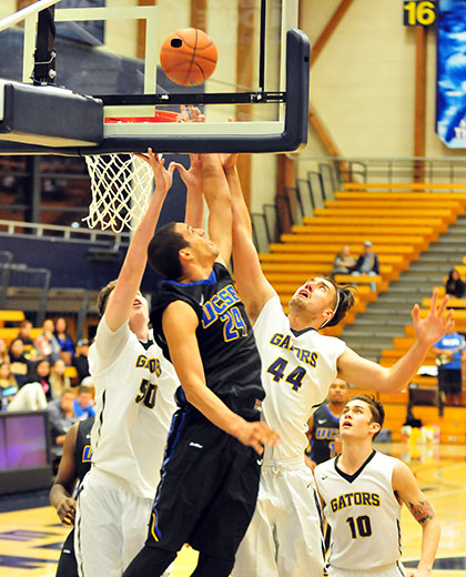 Michael Bryson gets to the hoop for a contested basket in the second half.