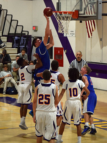 Sophomore Jackson Stormo puts in a layup against Righetti.