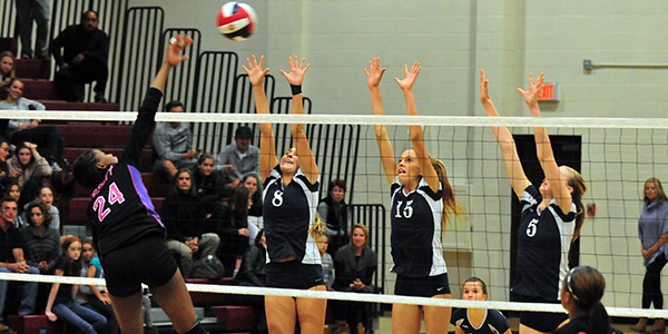 Laguna Blanca's Phoebe Madsen, left, Laurel Kujan and Caylin Zimmerman block against Desert's Devyn Cross