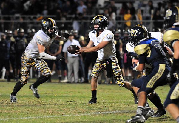 Ventura's Tyler Smith hands off to running back Broc (Presidio Sports Photo)