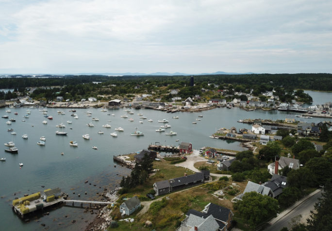 An aerial view of the bay full of fishing boats in Vinalhaven, Maine