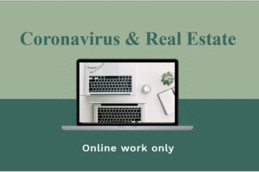 Computer with words Coronavirus and real estate - online only
