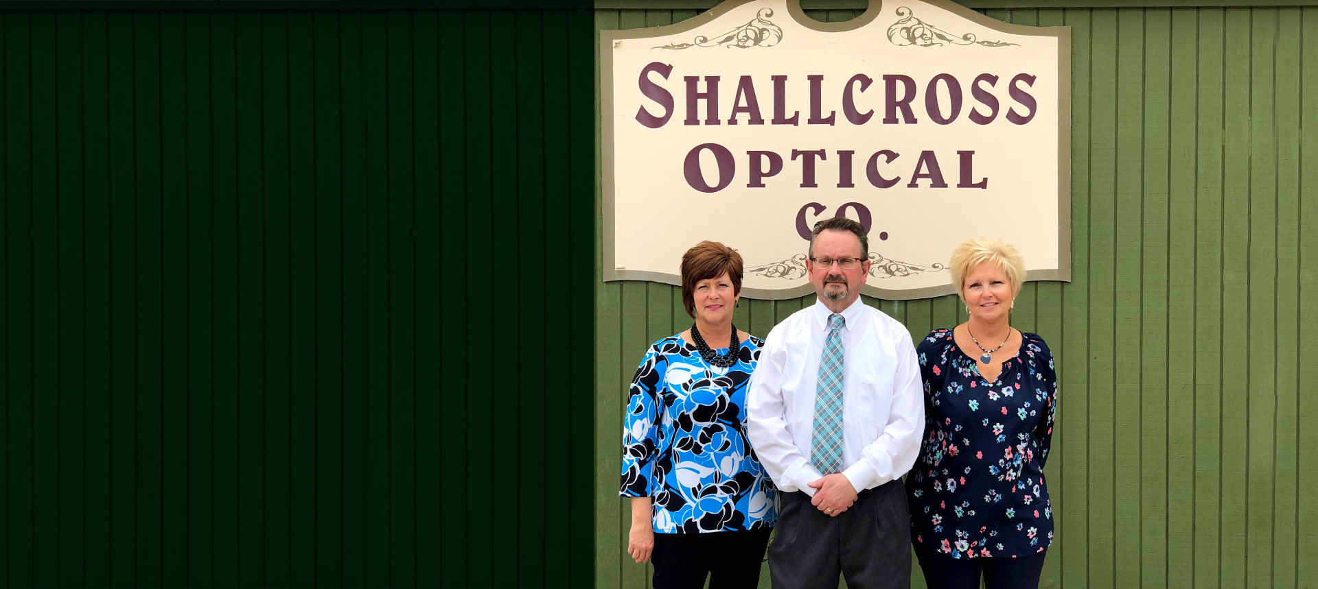 The team in front of Shallcross sign