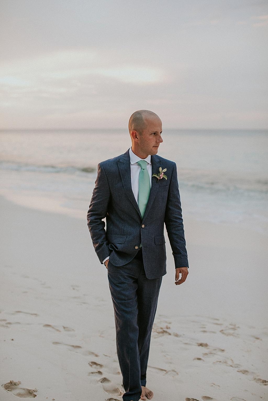 groom portraits on the beach