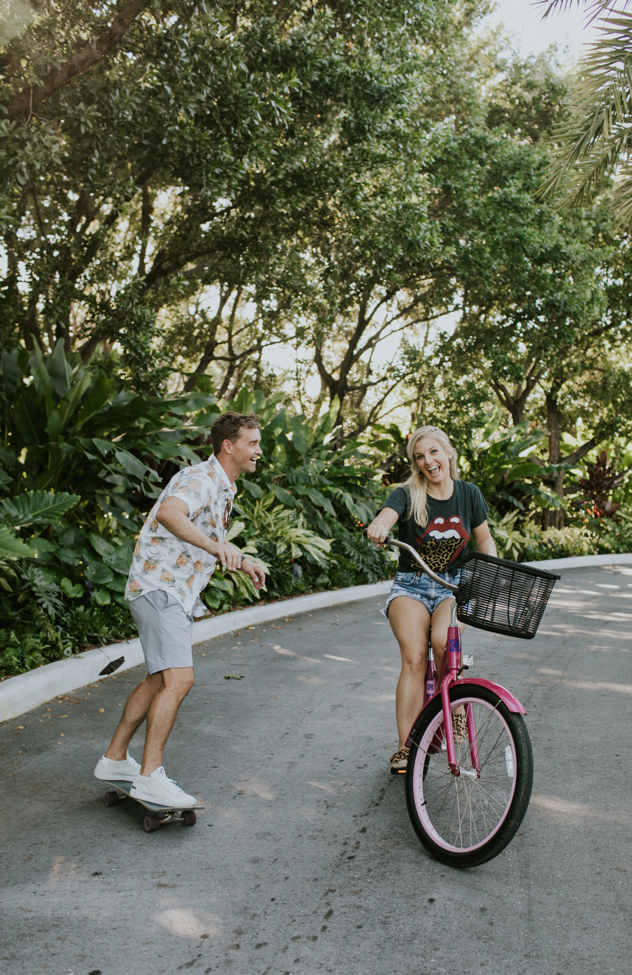 Cute couple riding bikes during their engagement session