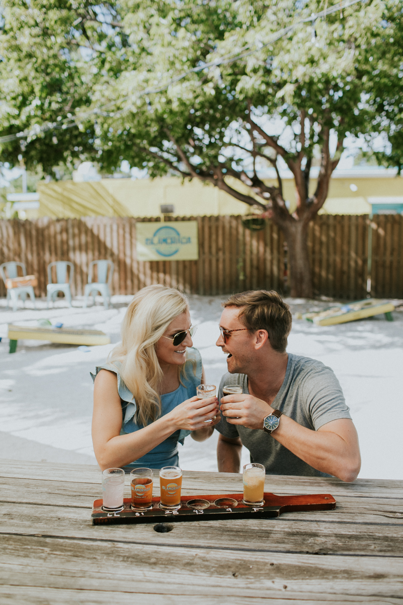 A couple enjoying a few beers during their engagement session