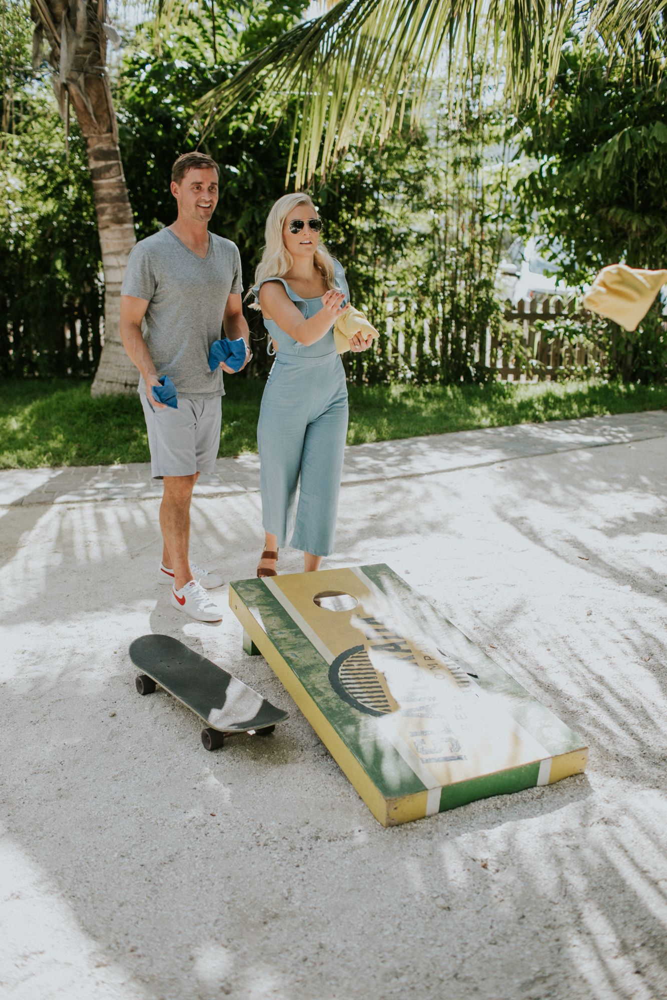 Cornhole game during an engagement shoot in the florida keys