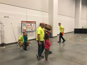 Learn 2 Fish With Us volunteers work with youth at the 2018 Fox Cities Kidz Expo on Saturday, April 14, 2018
