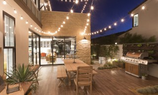 ES_Cut Coarse Stone_Oyster_Exterior_patio_IBS 2016 Responsive Home_night wide