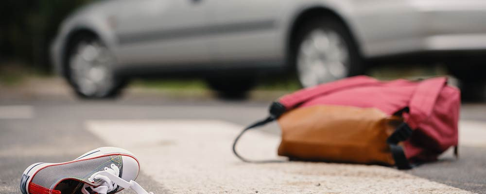 Pedestrian accident lawyer St Petersburg Florida - Photo of a car pulled over and a back pack and shoe in the road