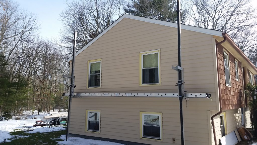 side of home with new vinyl siding
