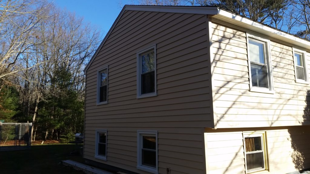 home exterior after new vinyl siding applied