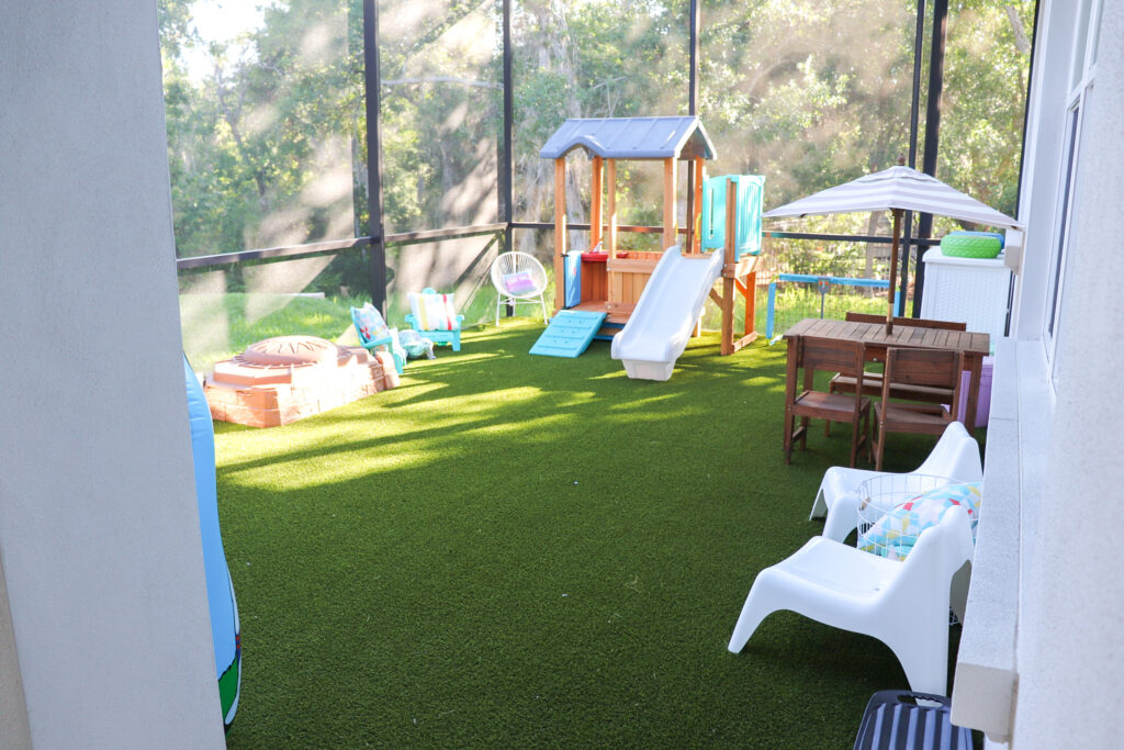 Outdoor Play Area For Kids, artificial turf play area, screened in play area, outside play area for kids, backyard play area for kids, shaded play area for toddlers, toddlers outside play area, mud kitchen