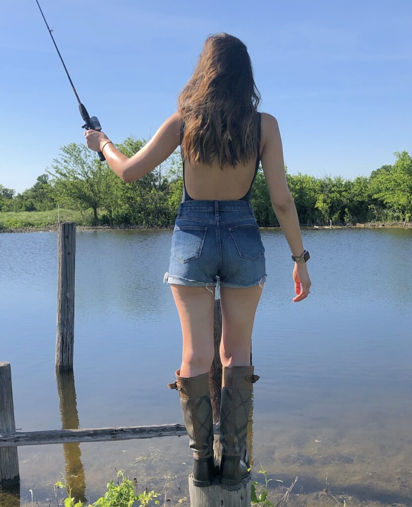 posing with a fishing pole