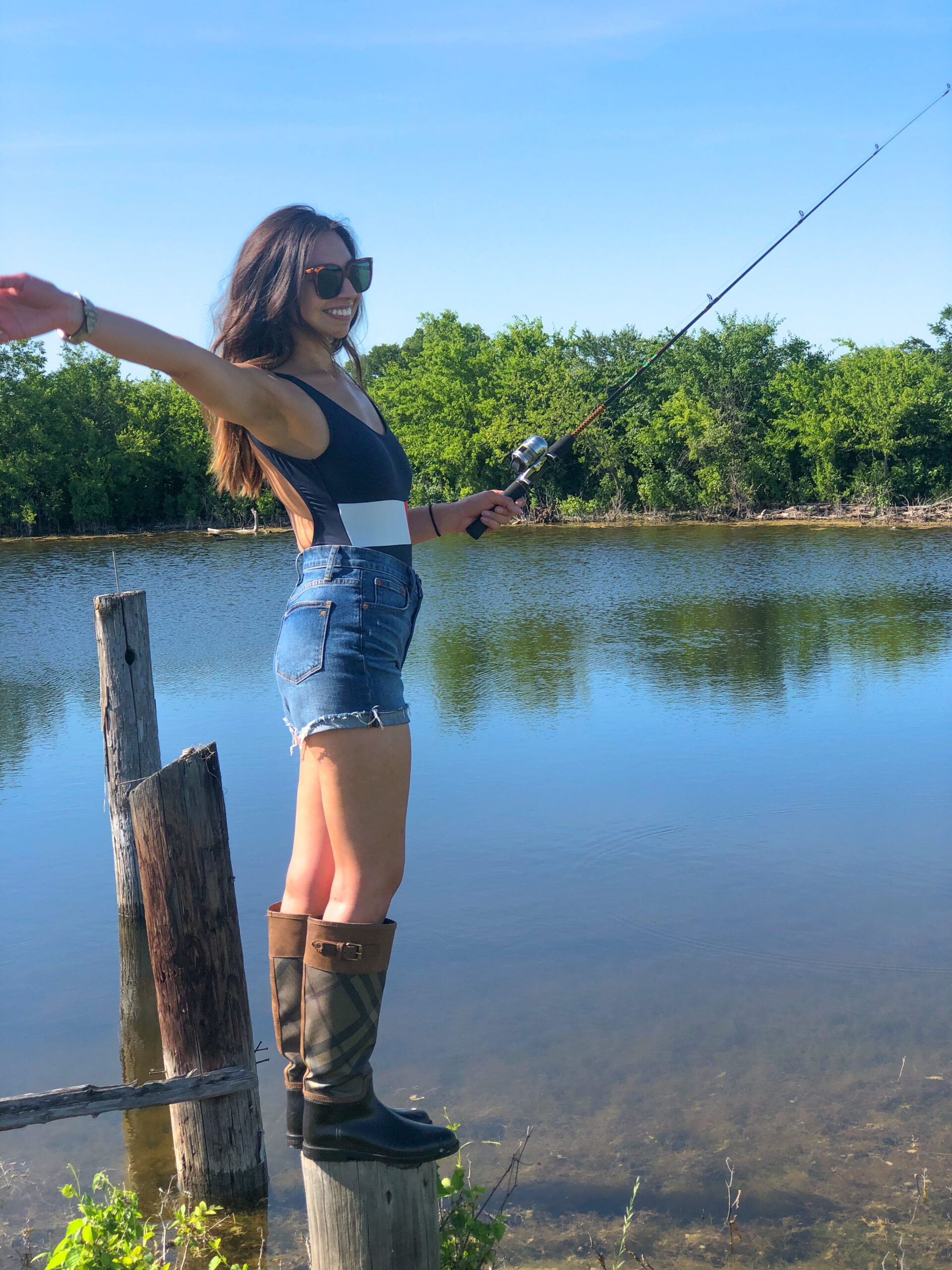 side pose with fishing pole