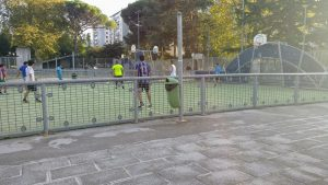 Playing soccer with people from town