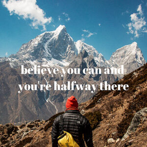 """image of a person from behind standing in front of mountains with the words """"Believe you can and you're halfway there"""""""
