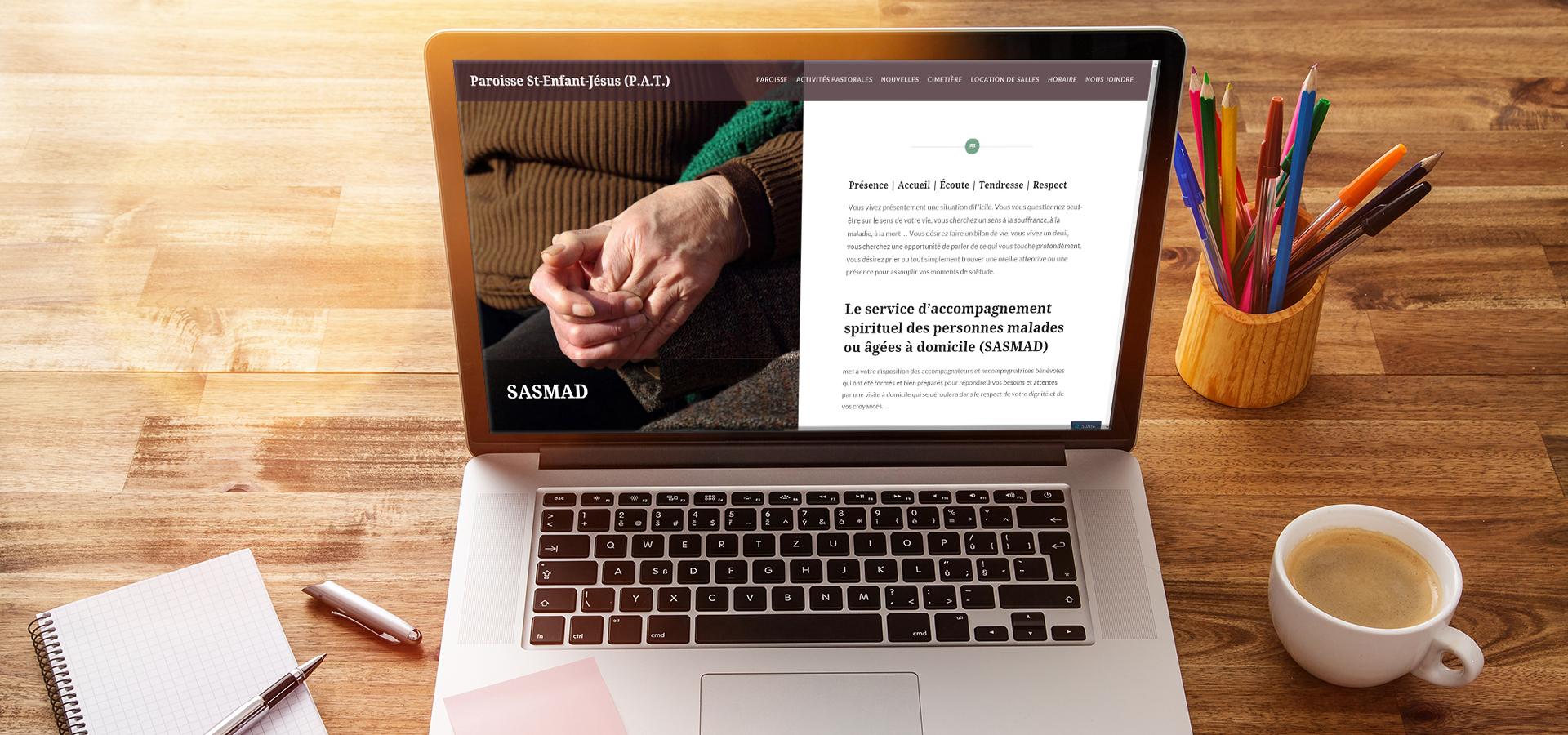 Paroisse-sej website on a laptop on a desk