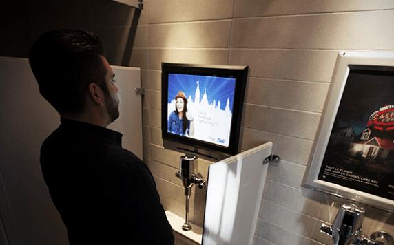 Man before frame at urinal