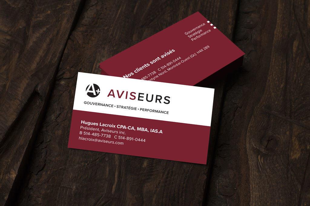 Aviseurs business cards on wood table
