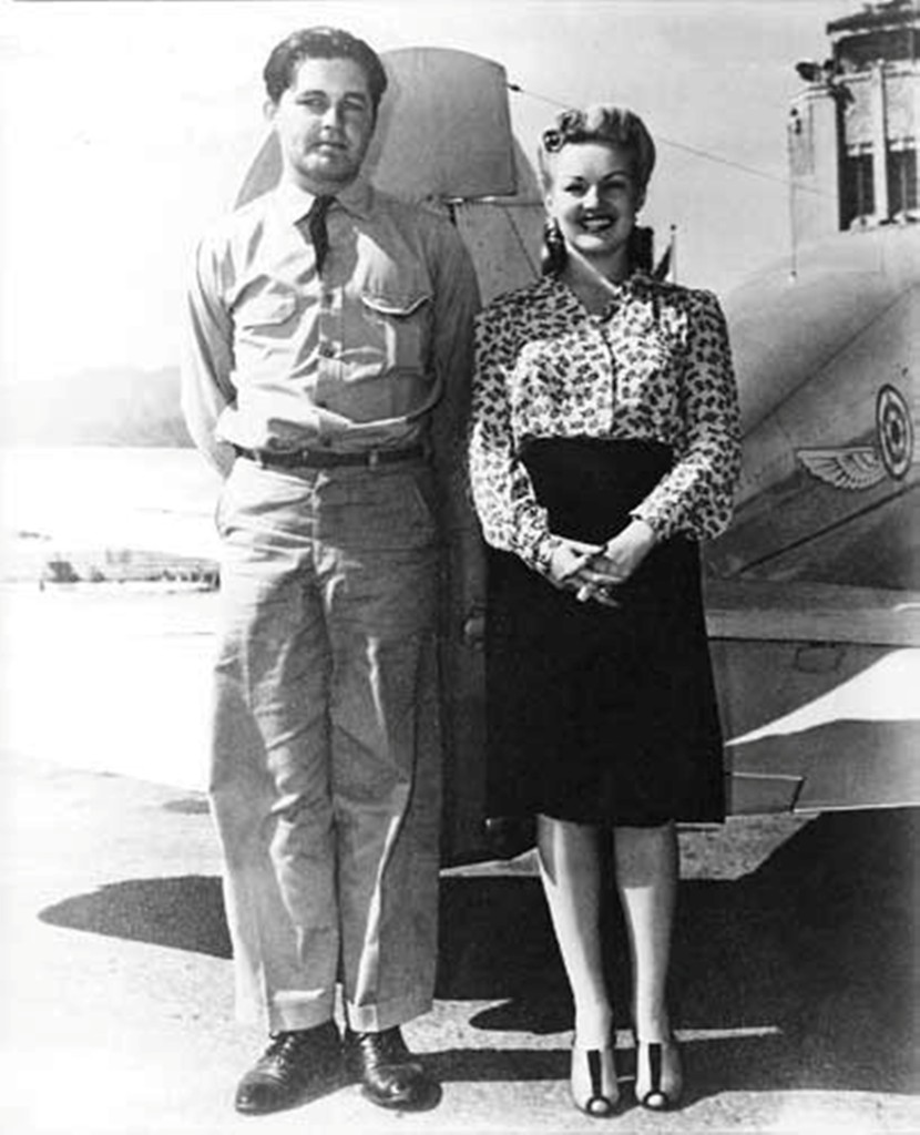 Betty Grable and unknown soldier in front of S/N 17
