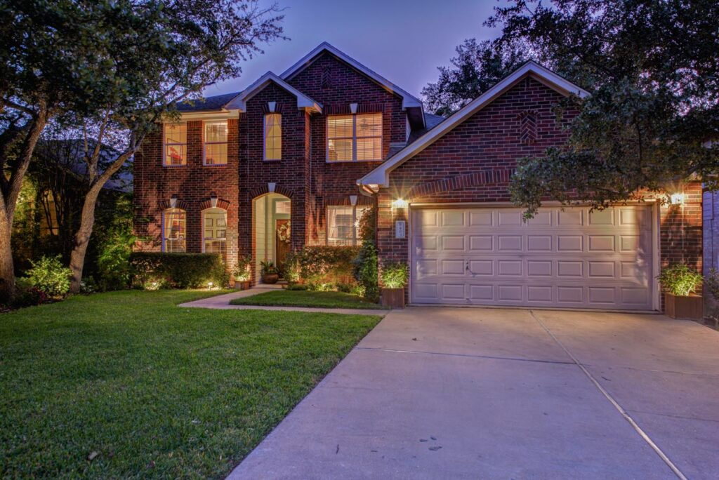 Twilight photography of a brick home taken by an Austin Real Estate Photographer