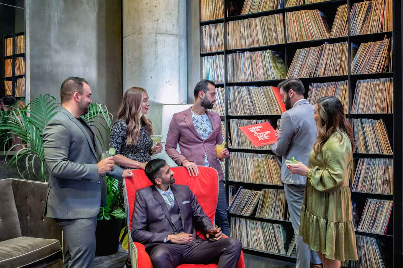 People standing in a record room in a hotel
