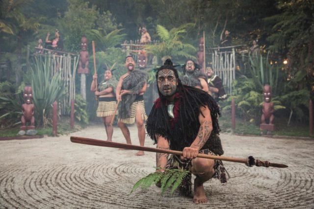 Maoris lay a leaf