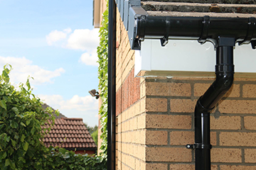 white and black fascias and guttering on a modern home