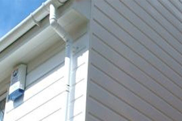 white cladding in roofline system