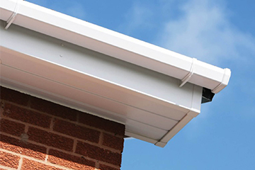 white soffits of a roofline system on a red brick house